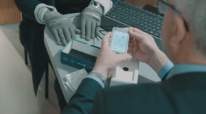 Pharmacist using device with patient healthcare public relations